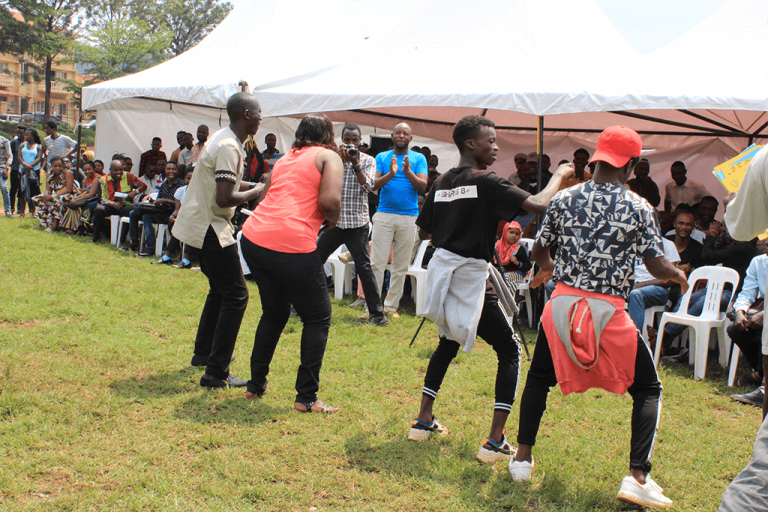 Refugee Law Project staff joins participants in a dance moment